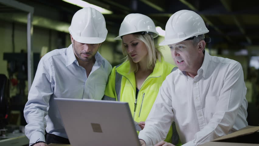 Male and female warehouse workers are looking at a laptop computer and discussing the logistics of their business. In slow motion. | Shutterstock HD Video #3808076