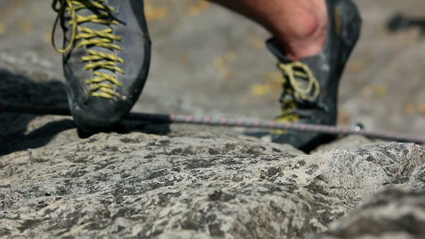 Close up of a leg movement while rock climbing
