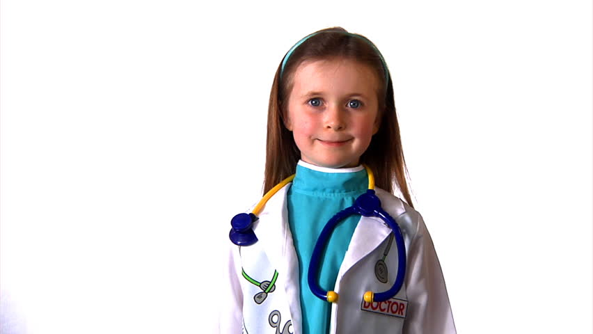 A little girl dressed up as a doctor, proudly smiles at camera