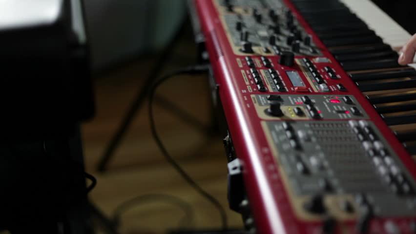 Close up shot of musician playing keyboards | Shutterstock HD Video #3860147
