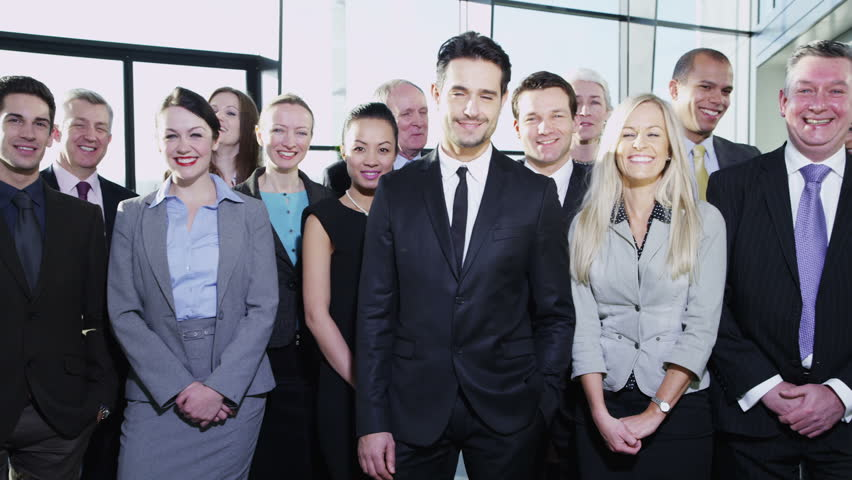 Portrait of a diverse group of business people in a large modern office building. In slow motion. | Shutterstock HD Video #3872426