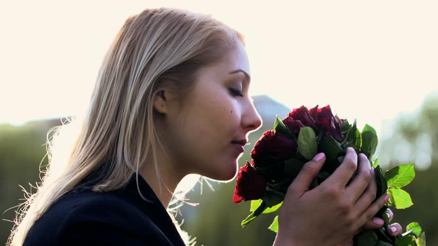young women smelling on roses. love background. romantic. valentines day. gift giving. happy dream.blond hair. single female  #3878927