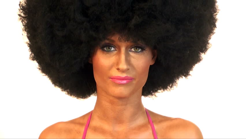 Young beautiful woman is dancing in with afro hair