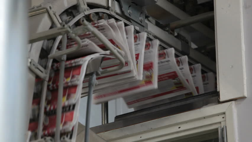 printed newspapers ready for folding