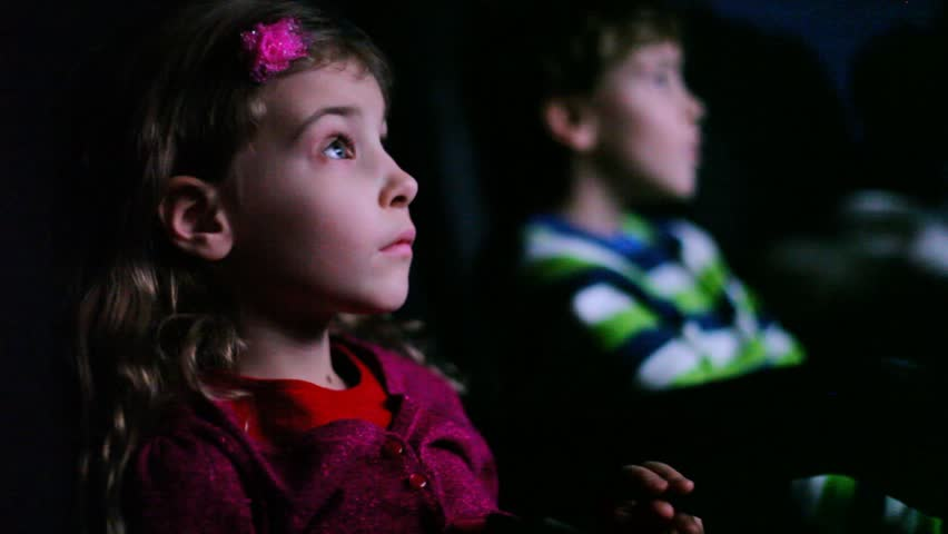 Boy and girl sitting in movie theater