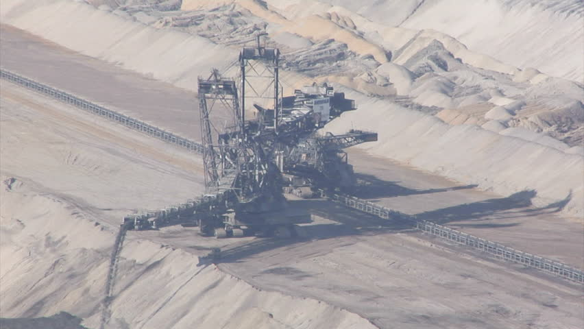 HAMBACH, GERMANY - SEPTEMBER 05: Lignite strip mining, zoom out. The open-pit strip mining facility Tagebau Hambach is Germany's largest strip mine and regularly debated for environmental issues.