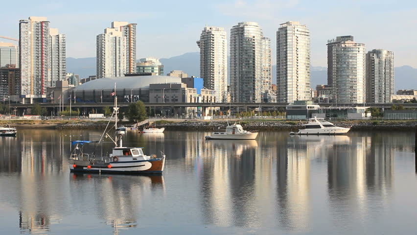 False Creek Boats, Vancouver Cityscape. An early morning view of downtown Vancouver's skyline reflected in the still waters of False Creek. British Columbia, Canada.