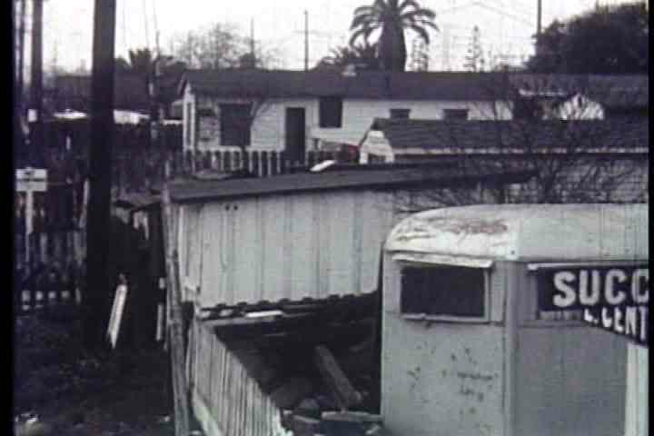1950s - Shacks, trailers and weather beaten bungalows line the streets of Watts in 1957.