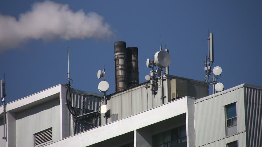 Long Shot Of Television Antennas And Chimneys On Roof. TV Antennas ...