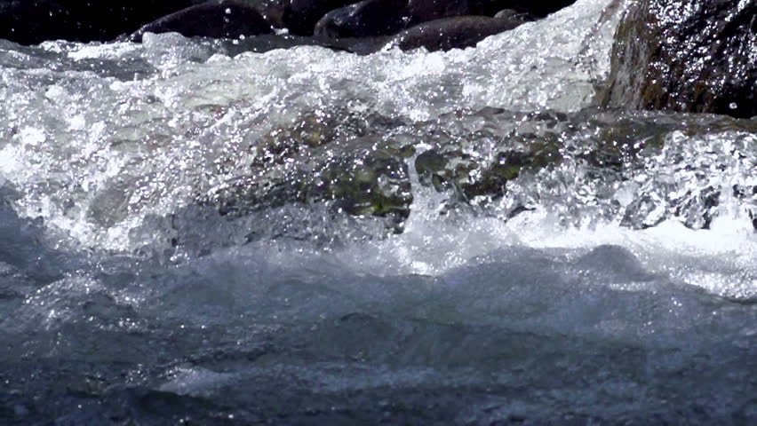 Raging Mountain river. Wildness of clean, clear water in the mountain river. Slow Motion at a rate of 480 fps