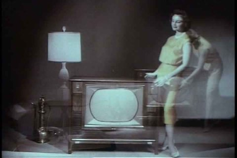 1960s - The wonders of the newly invented remote control are displayed along with wonderfully corny shots of a model displaying a retro television set.
