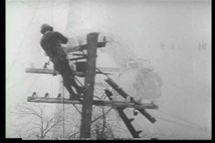 1940s - Archival black and white film highlights the efforts of telephone installers and line repairmen that keep the nation's telephone system running.