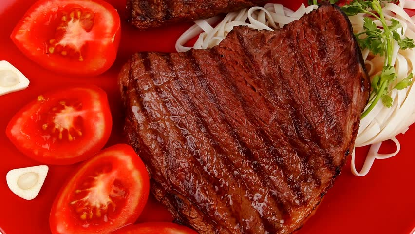 italian food : pasta with tomato on basil and roasted sirloin beef steak on plate 1920x1080 intro motion slow hidef hd