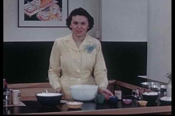 1940s - Adding milk, vanilla and eggs to cake mix in this archival cooking show from 1945.