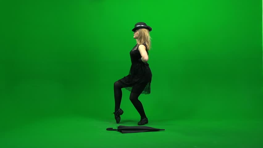 dancing women with umbrella isolated against green screen