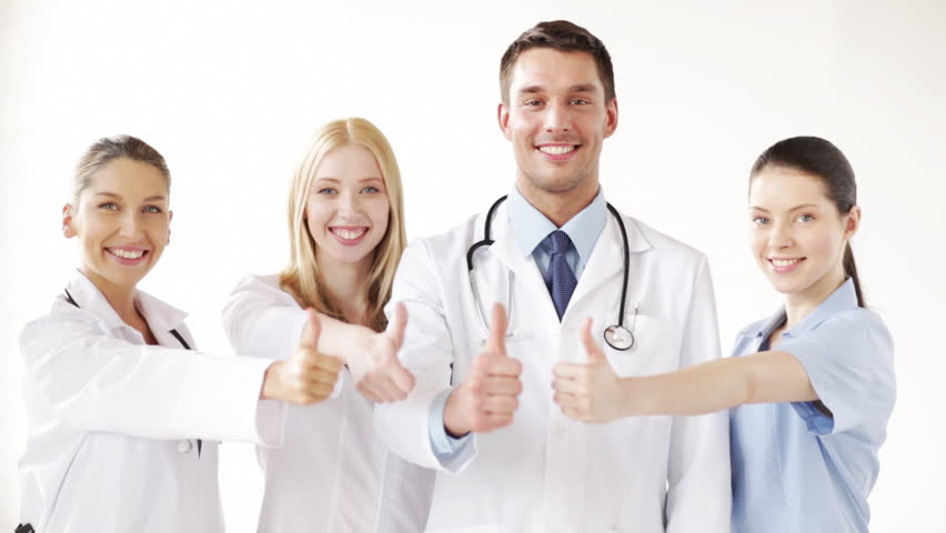 Group of doctors with thumbs up at the hospital  | Shutterstock HD Video #3955307