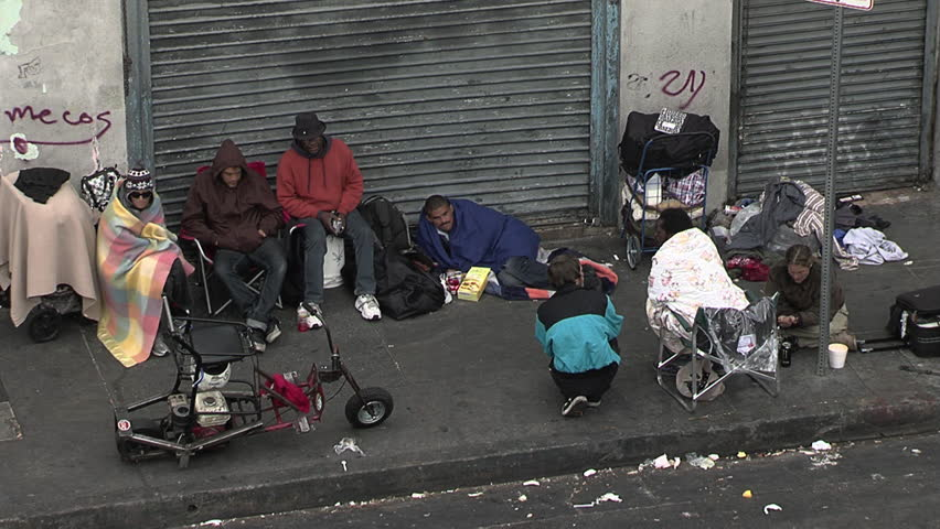 LOS ANGELES, CA - CIRCA MARCH 2012 - Skid Row in Los Angeles across from the Midnight Mission.  Homeless people congregate on the street.
