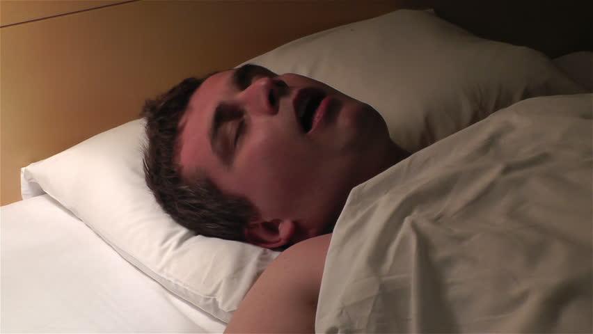 Man Sleeping at Night and snoring