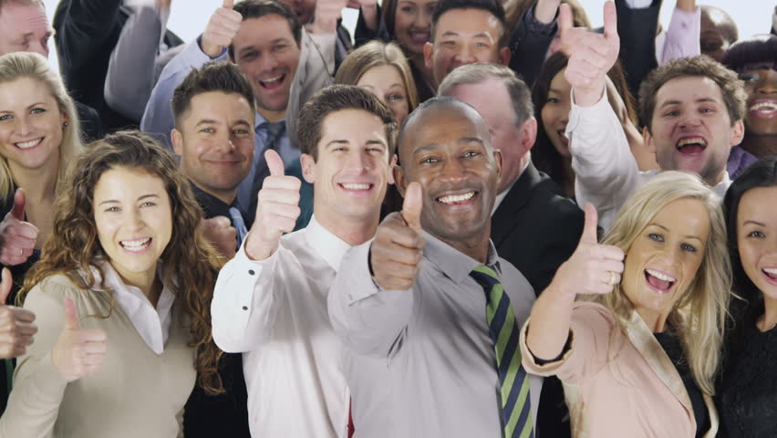 Portrait of a diverse group of business people who are standing together, isolated on white in a studio shot. They hold their thumbs up to camera to celebrate their business success. In slow motion. | Shutterstock HD Video #4010617