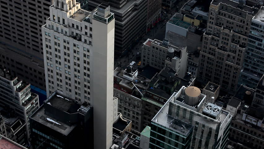 Zoom to the top of tall buildings with small cars and pedestrians in Downtown Manhattan, New York City / HD1080 / 29.97fps