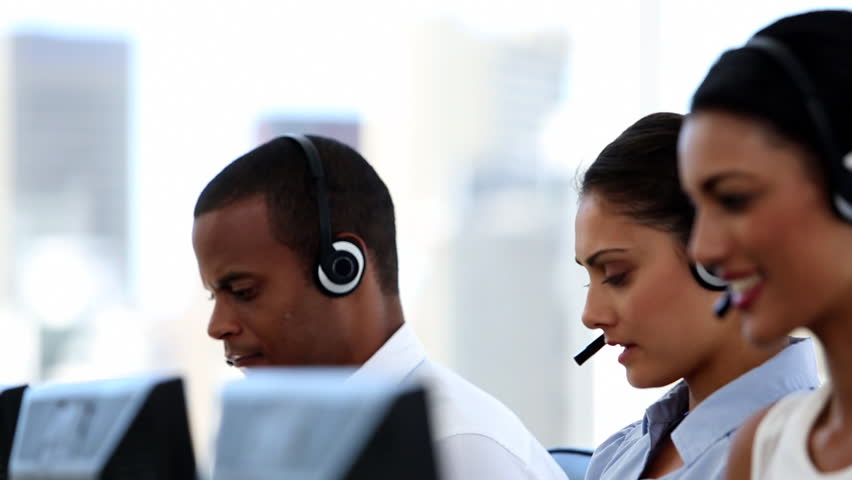 Group of agents in a call centre smiling and helping people | Shutterstock HD Video #4050340