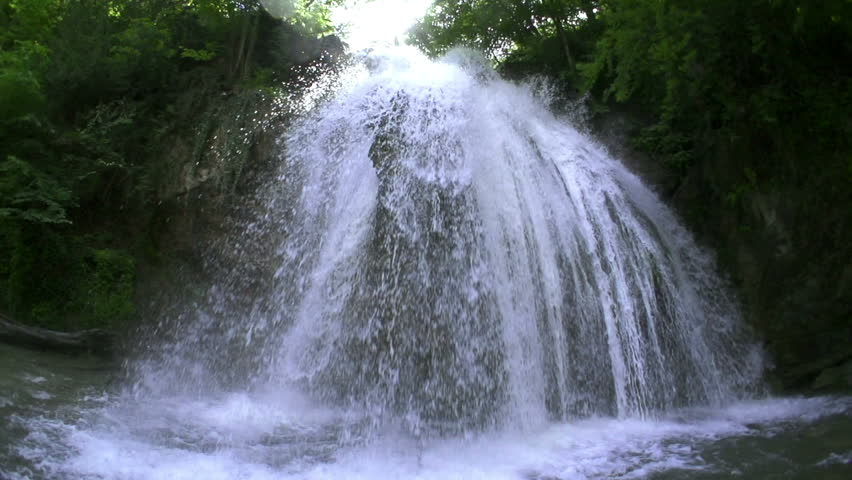 waterfall in mountains in slow motion, high speed reel. super slow motion dolly shot.  #4076443