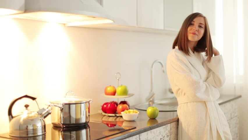 Woman In Bathrobe Stands In The Kitchen And Smiling Stock Footage ...