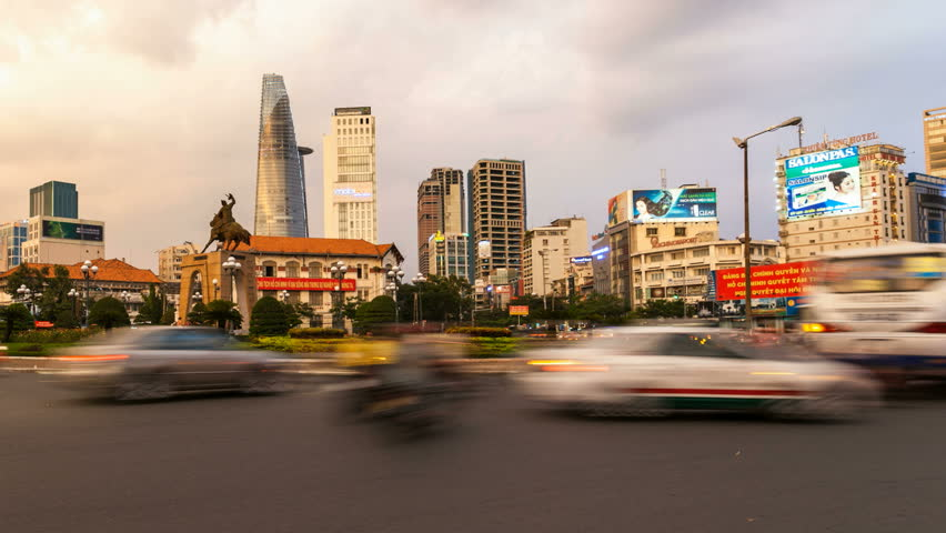 HO CHI MINH CITY - JUNE 9: Time lapse view of traffic in front of Ben Thanh