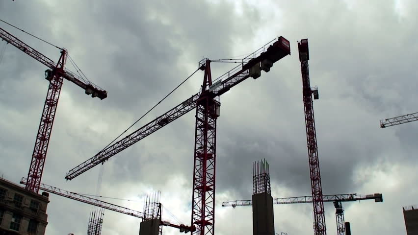 Large construction cranes timelapse