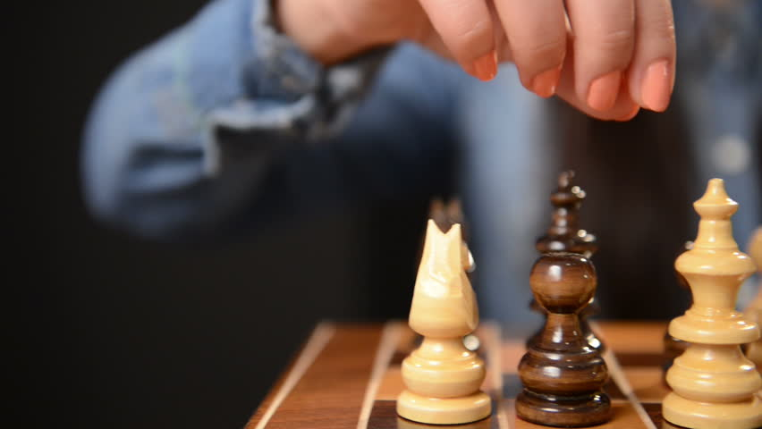 girl moving chess queen