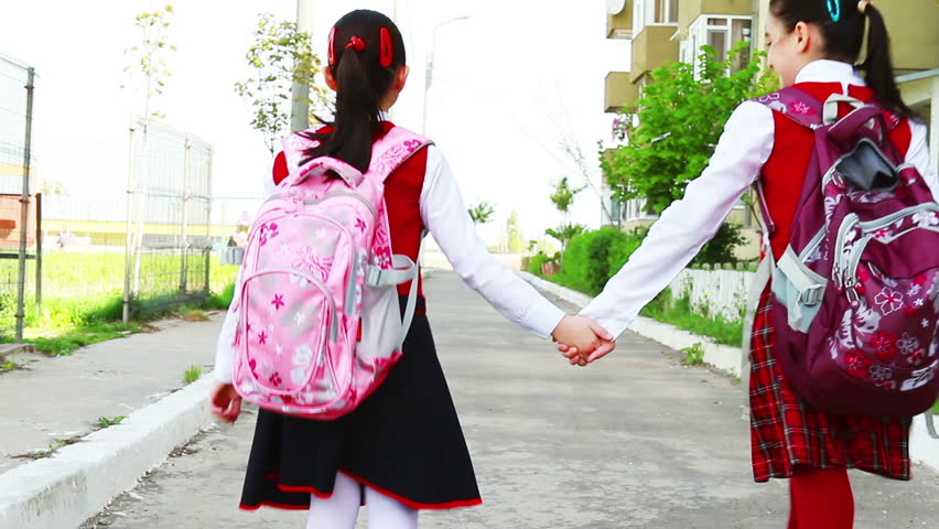 Stock Video Of Little Student Girls With Bags Going -7590