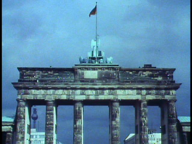 BERLIN - GERMANY - CIRCA - 1988: Berlin, Germany, Brandenburg Gate, medium shot, zoom out wide to reveal Berlin Wall