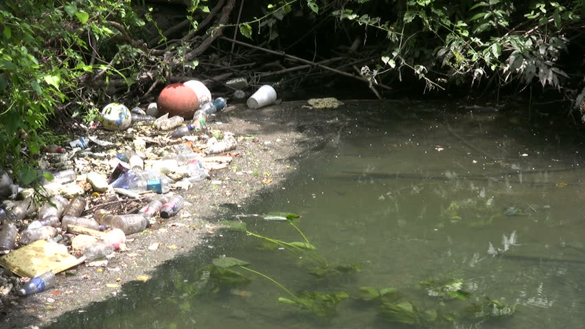 Video of the San Antonio River in Texas. Slow flow of water and lots of trash and junk. Water pollution and filth. Disgrace to society. Don Despain of Rekindle Photo