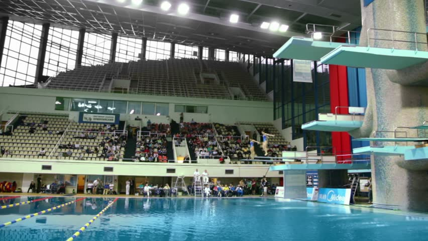 moscow apr 13 female pair jump during competitions on synchronized diving in pool of