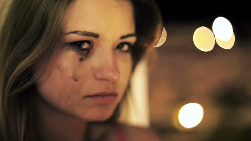 Beautiful sad woman crying in the night