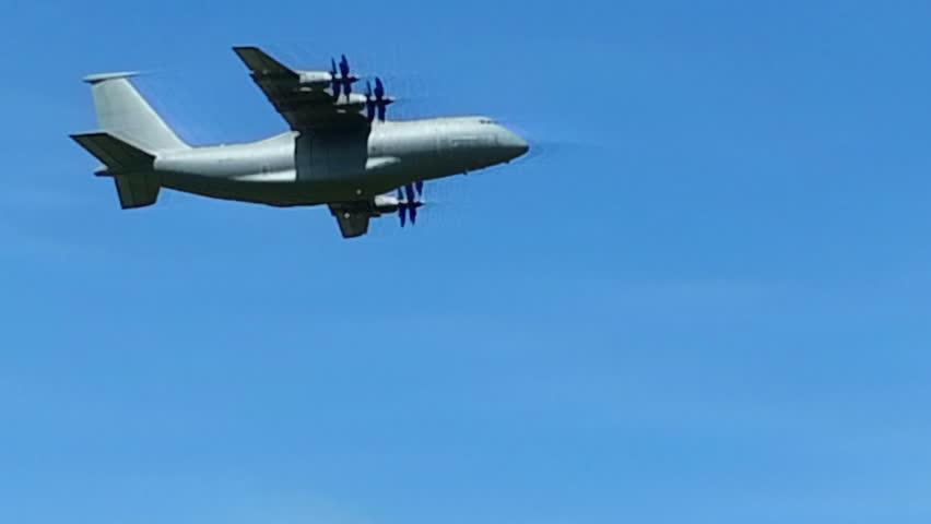 Freight carrier AN-70 flying over camera on air show