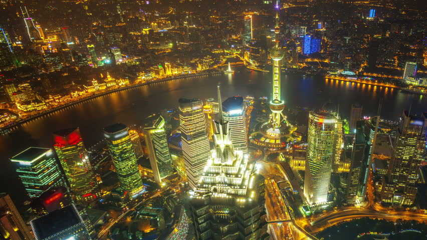 China Shanghai, time lapse(move up).  Aerial view of high-rise buildings with Huangpu River in Shanghai, China. Jin Mao Tower ( (one of China's tallest buildings) and Oriental Pearl Tower.