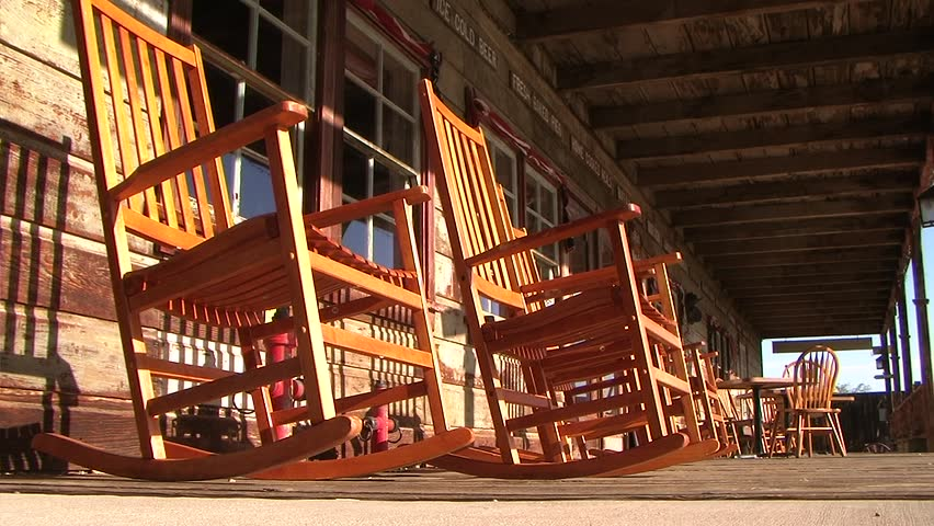 Rocking Chairs In The Wind On An Old Porch. Ghost Town.