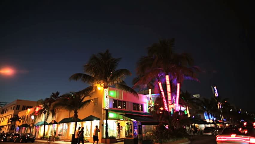 Night P.O.V. driving by illuminated restaurants on Ocean Drive Miami Art deco district of South Beach Florida, USA #4231747