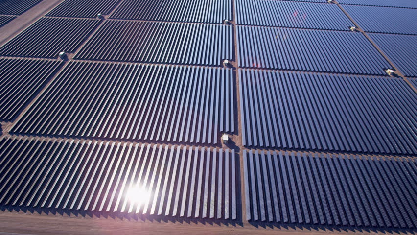 Aerial view large industrial Solar Energy Farm producing concentrated solar power, USA