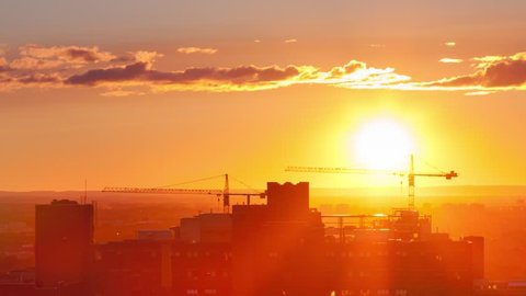 A Time-Lapse of the Sun setting over the city and disappearing behind the horizon.