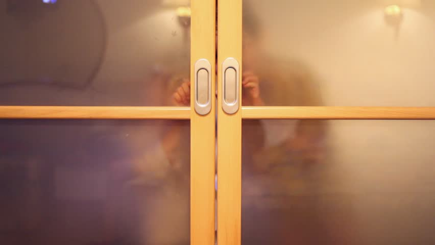 Two children are smiling and open the doors