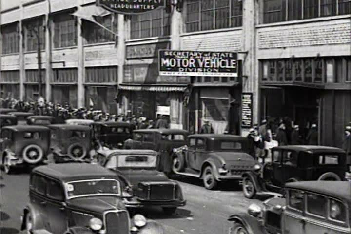 1930s - Drivers wait in line for 1934 license plates.