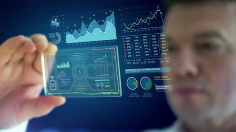 HD 1080 video of a businessman using futuristic tablet to analyze financial data