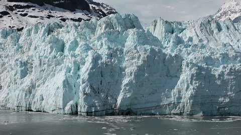 Margerie Glacier tidewater calving Glacier Bay slow motion. 21 mile long and a mile wide tide water glacier in National Park, Alaska.  One of the most active glacier for Calving. Geology environment.