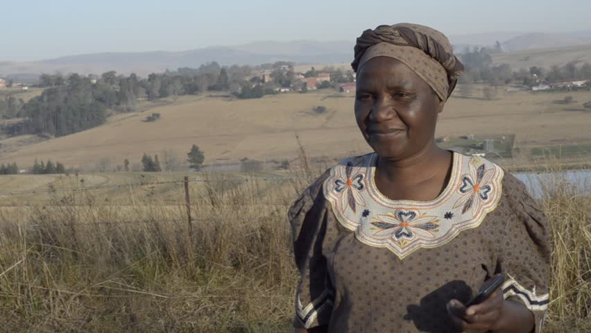 Traditional African Zulu woman speaking on mobile cell phone telephone in rural KwaZulu-Natal. | Shutterstock HD Video #4303817