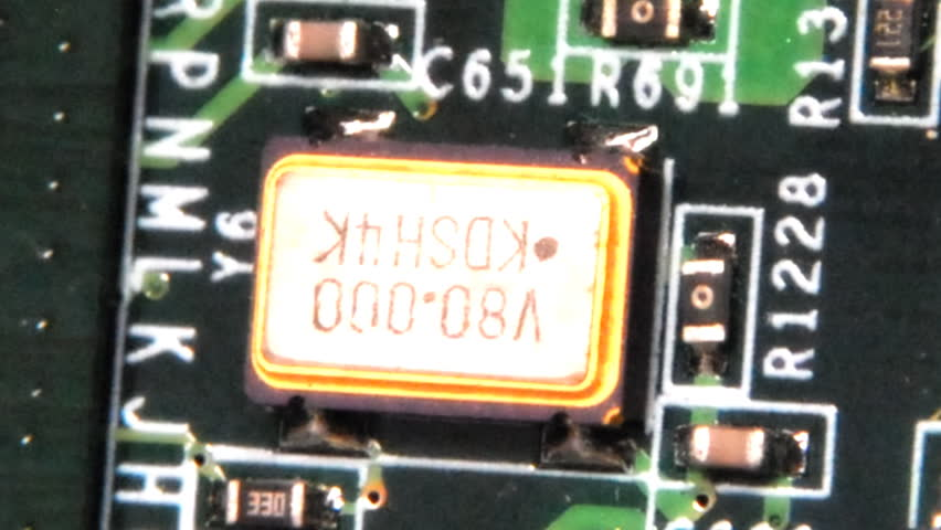 This footage is of a slow zoom of a computer ciruit board with effects