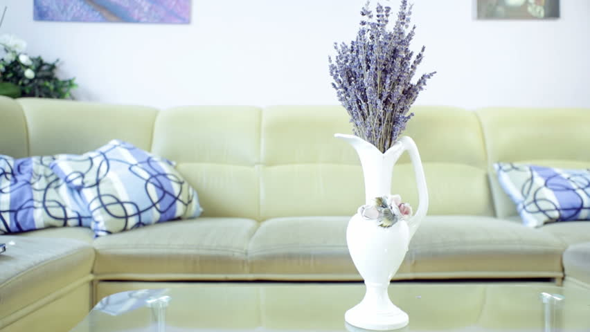 Living Room Vase vase of lavender flower on the table in living room, with sofa in