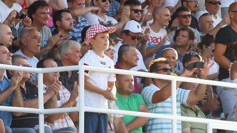 RIJEKA, CROATIA JULY 28: soccer fans on derby soccer match NK Rijeka (white) vs. NK Dinamo (blue) on July 28, 2013 in Rijeka.