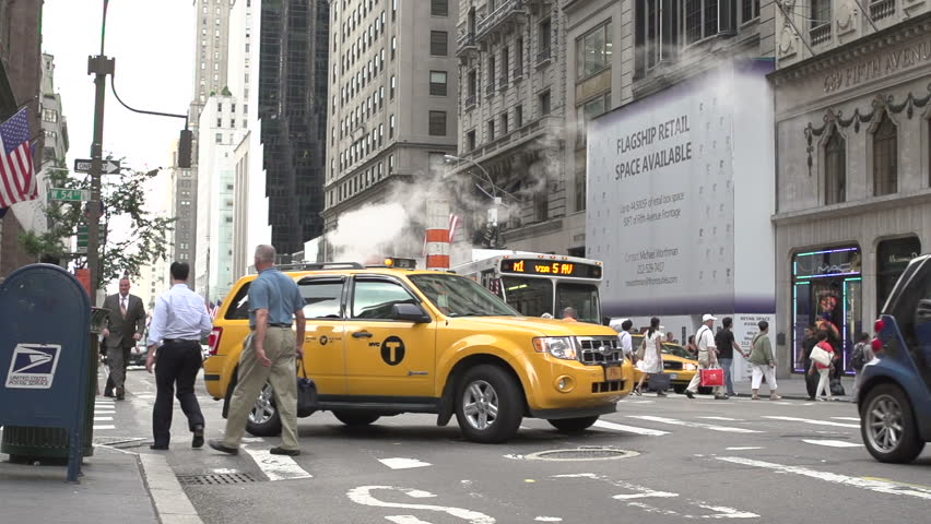 NEW YORK CITY, NY - JULY 8: NYC Taxi drives by slow motion on July 8, 2013 in New York City, New York.